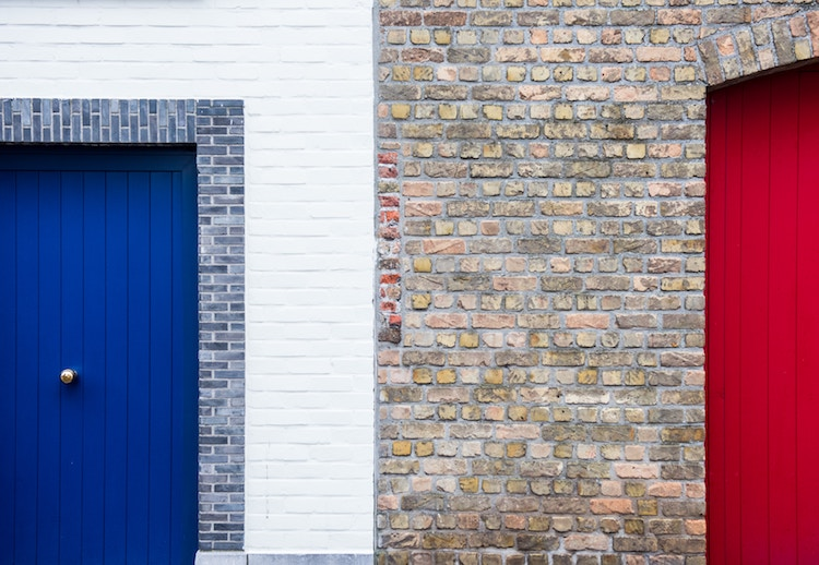 a wall with two house doors on it