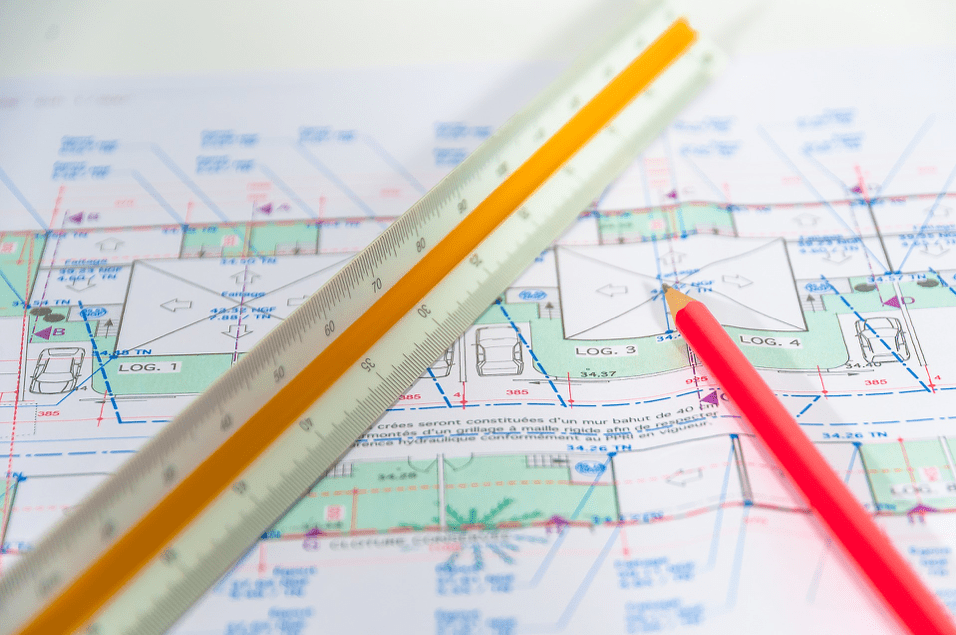A ruler and house plan drawn together by our structural engineering team