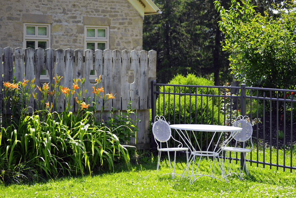 Party wall fencing with chairs and plants
