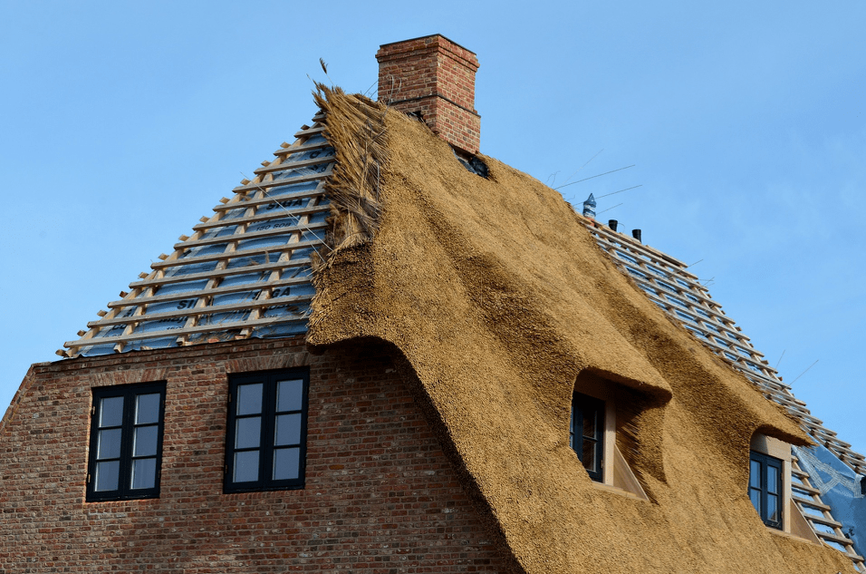 House with half completed thatched roof