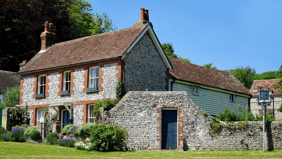 Old house with stone wall in rural England