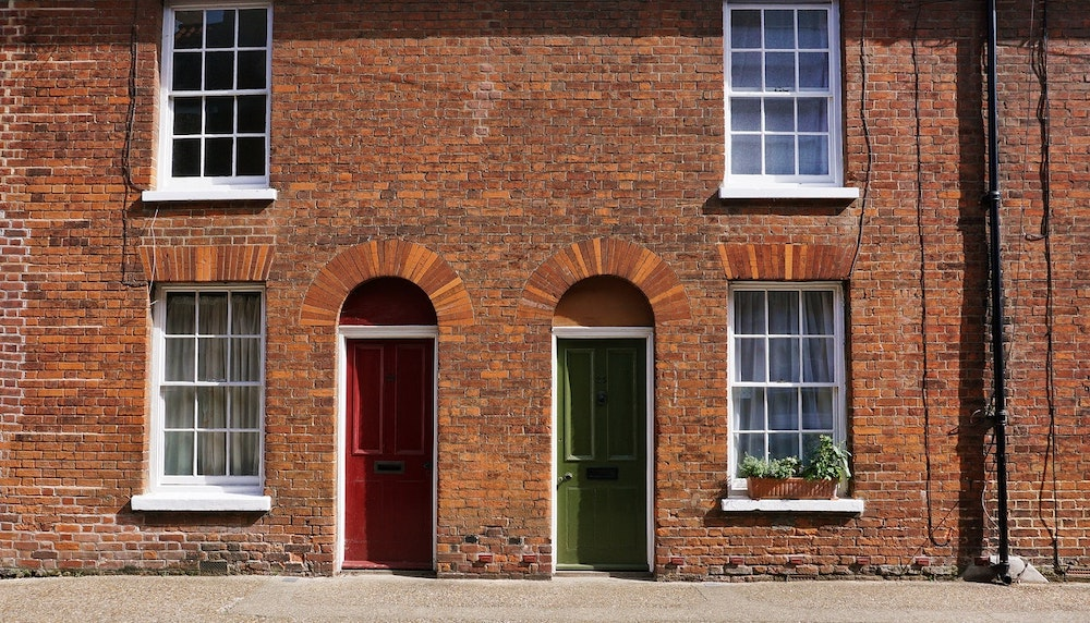 Brick houses with red and green doors.