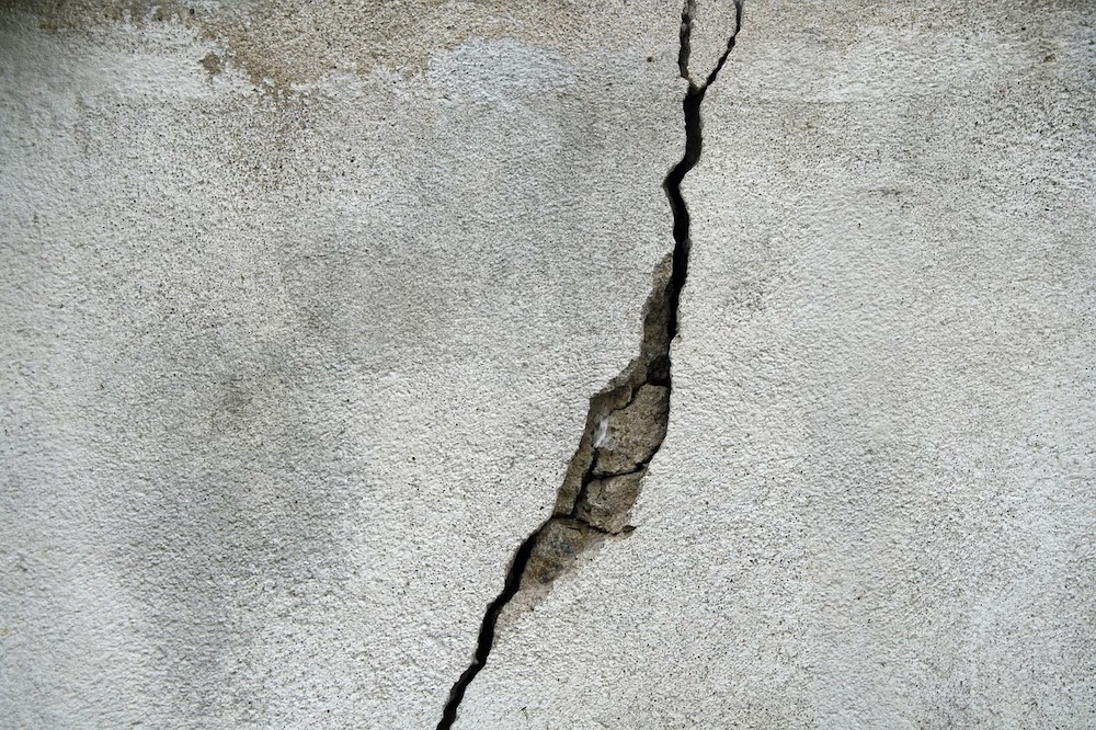 Deep crack in concrete wall.