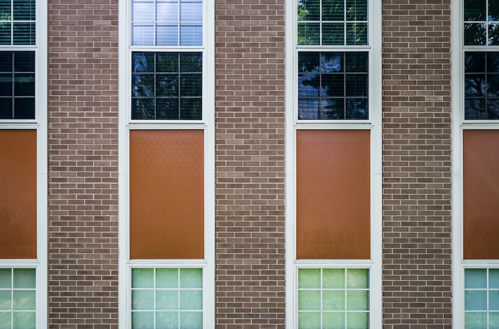 A symmetrical looking brick building with windows.