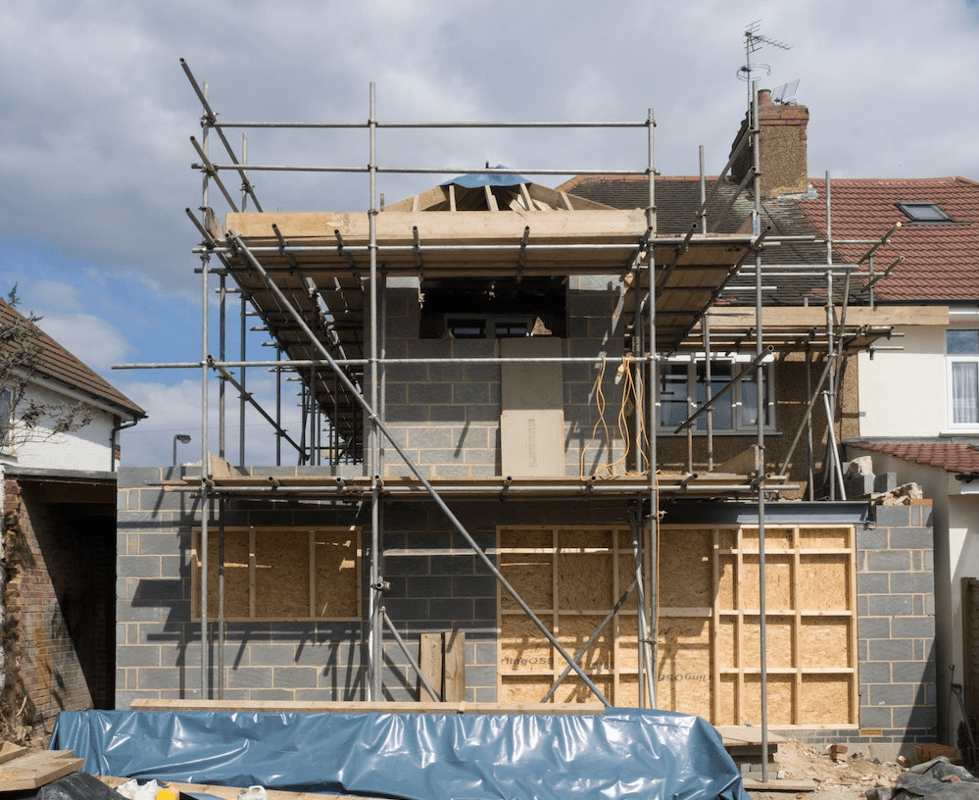 A house being constructed with scaffolding