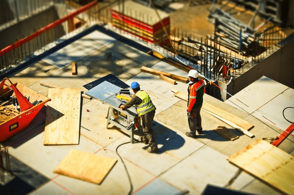 Two builders working on a construction site