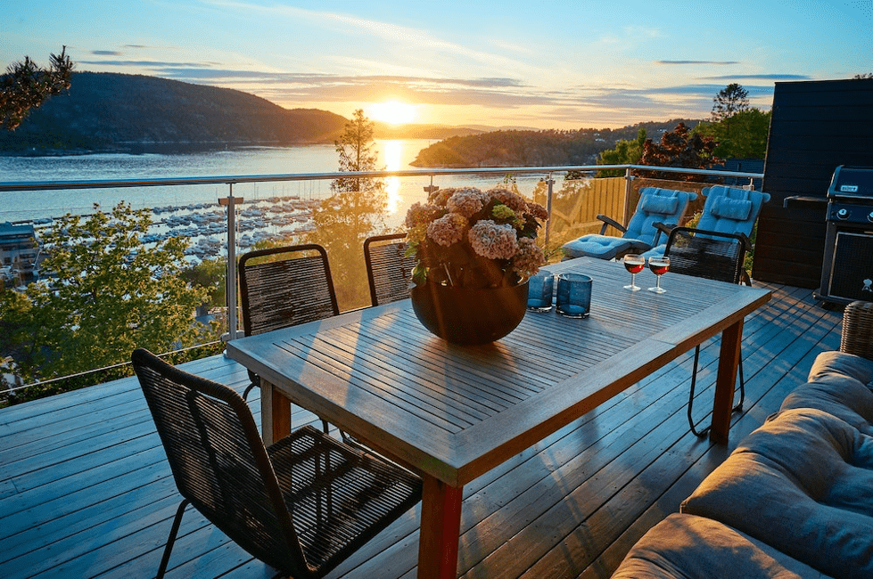 A balcony overlooking a sunset