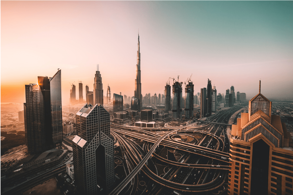 City of Dubai showing busy roads with the Burj Khalifa in the centre background