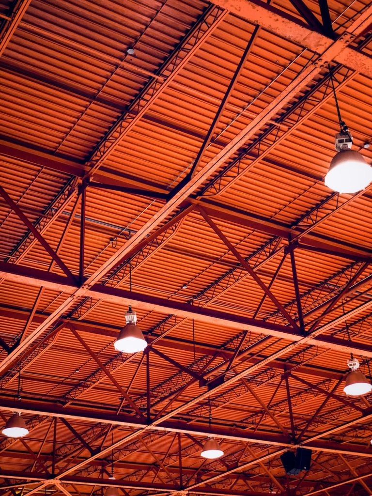 A red ceiling supported by steel beams