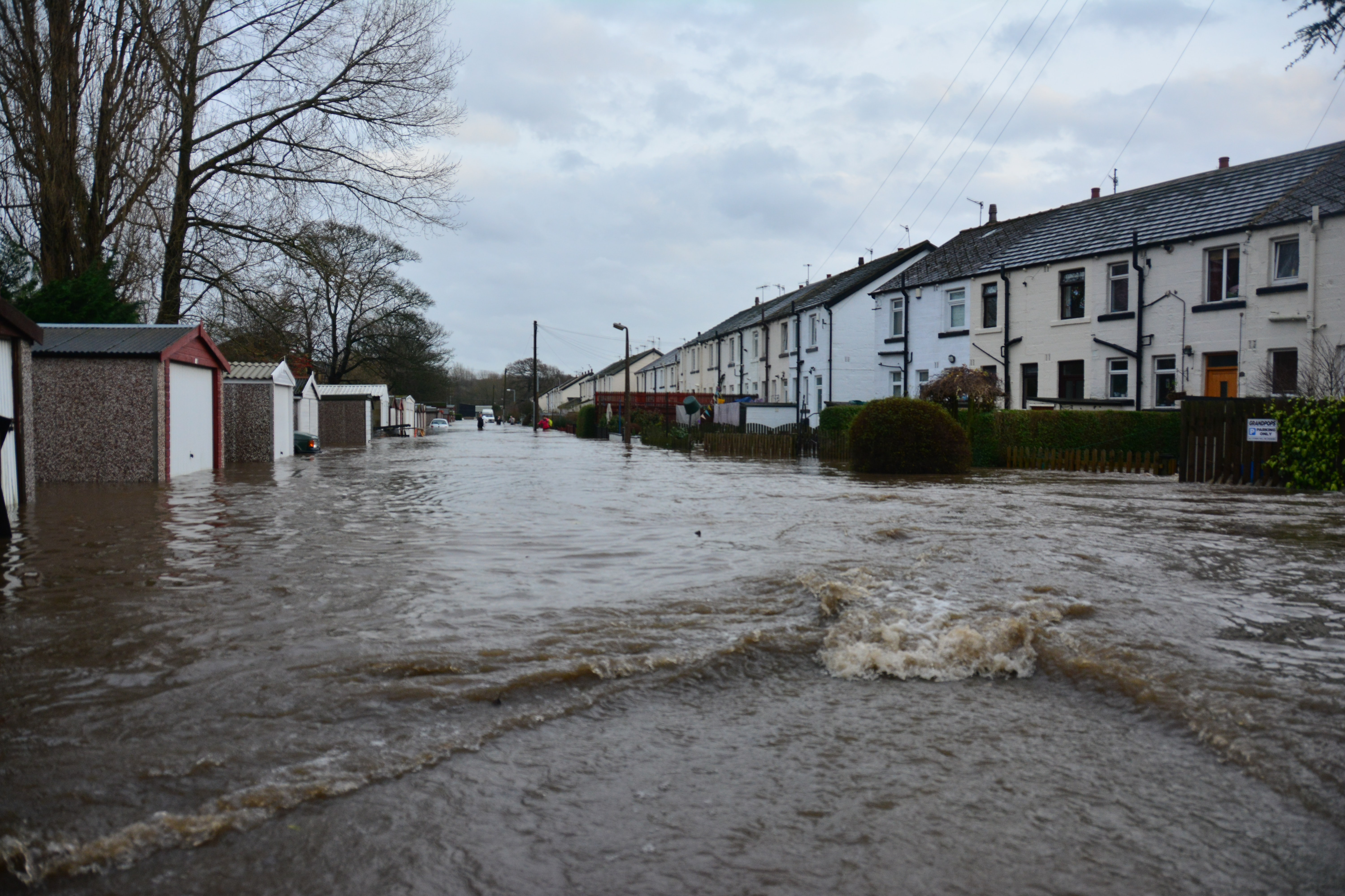 A flooded street of terrace houses