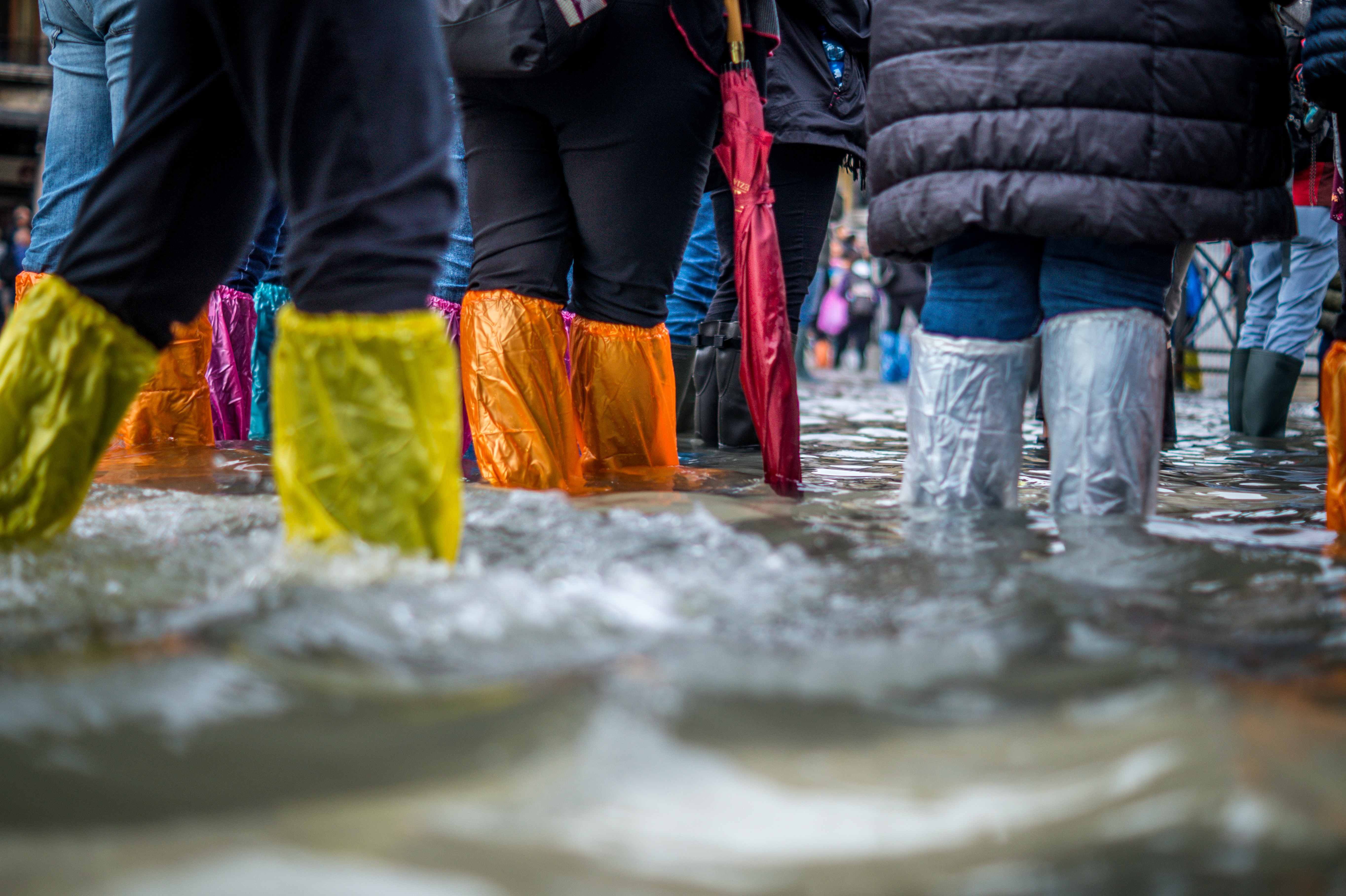 A group of people wearing wellies during a flood