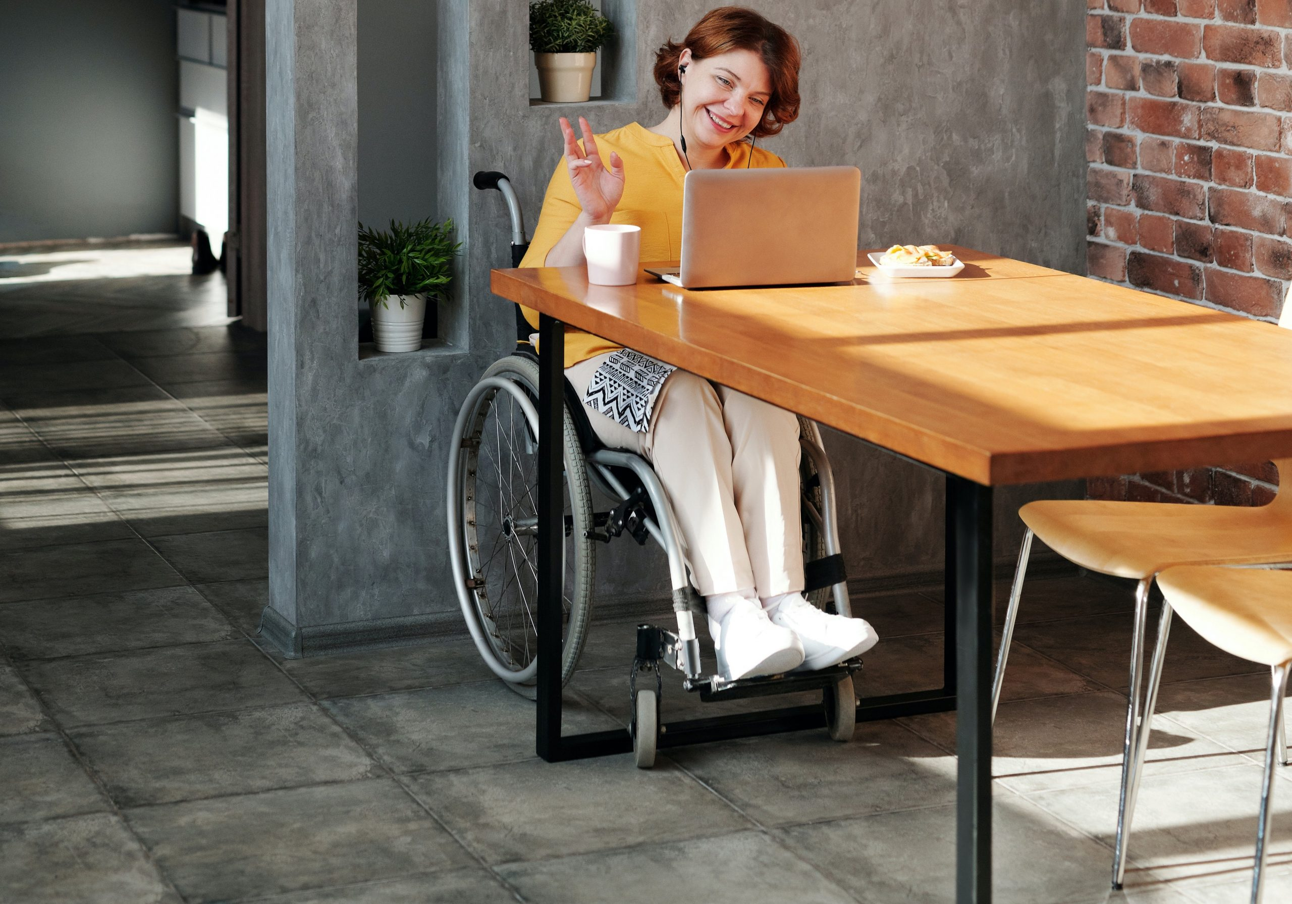 A woman in a wheelchair on a zoom call