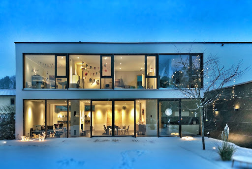 A home in winter with all the lights on