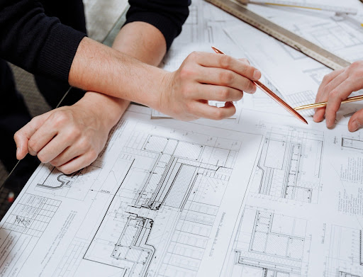 An engineer looking through structural plans