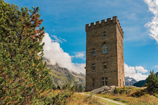 An old tower building on a hillside